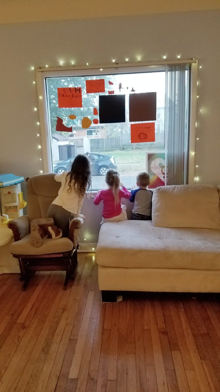 The kiddos watching out the window for the very first guest.